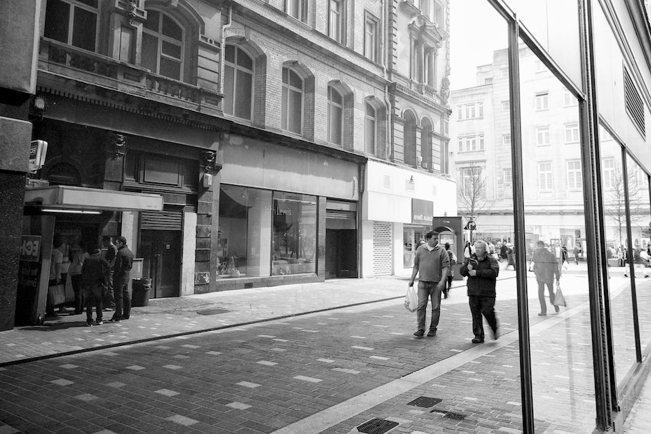 Shoppers reflected in shop windows - Basnett Street, Liverpool
