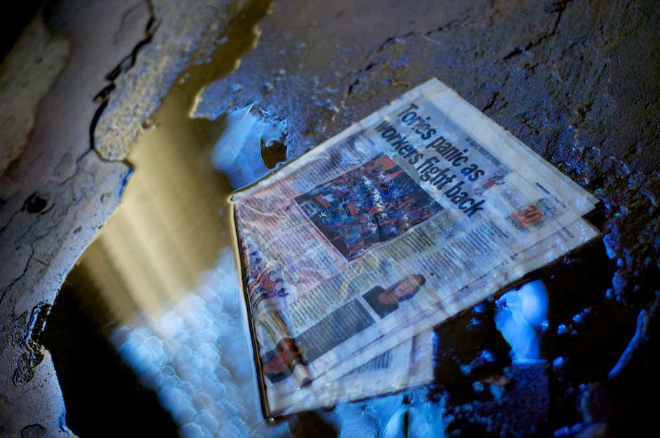 Copy of Socialist Worker newspaper in puddle