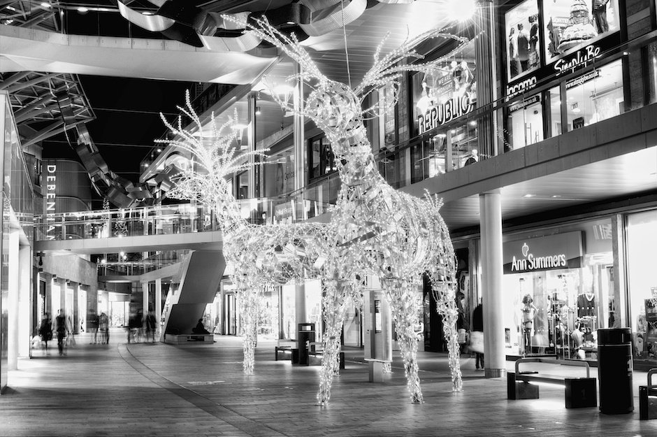 Black and white image of giant Christmas reindeers in Liverpool One