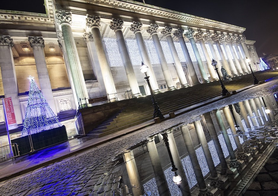 St Georges Hall, decorated for Chtistmas, reflected in a puddle