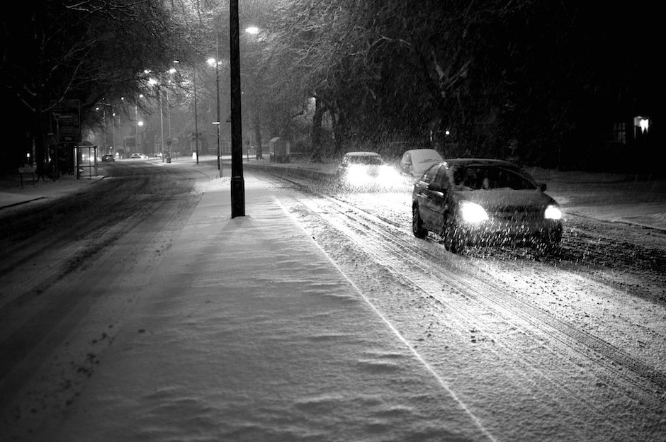 Cars creeping through heavy snow, black and white - Menlove Avenue, Liverpool
