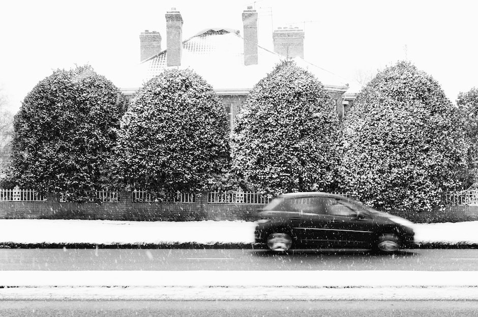 Car dashing through snow, Liverpool