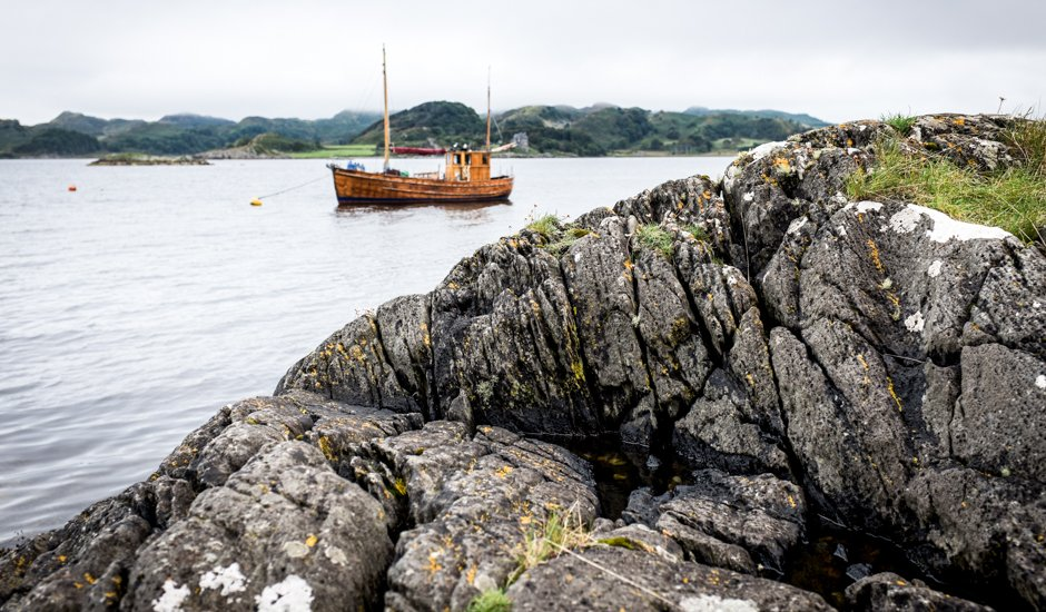 Fishing boat pictured with rocks, Crinan, Scotland