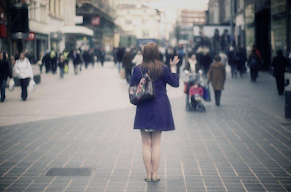Girl stood alone, waving, Church Street, Liverpool