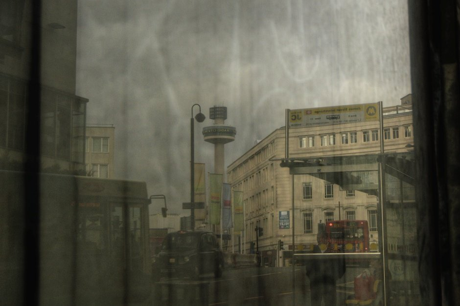 Liverpool city centre skyline reflected in dirty window