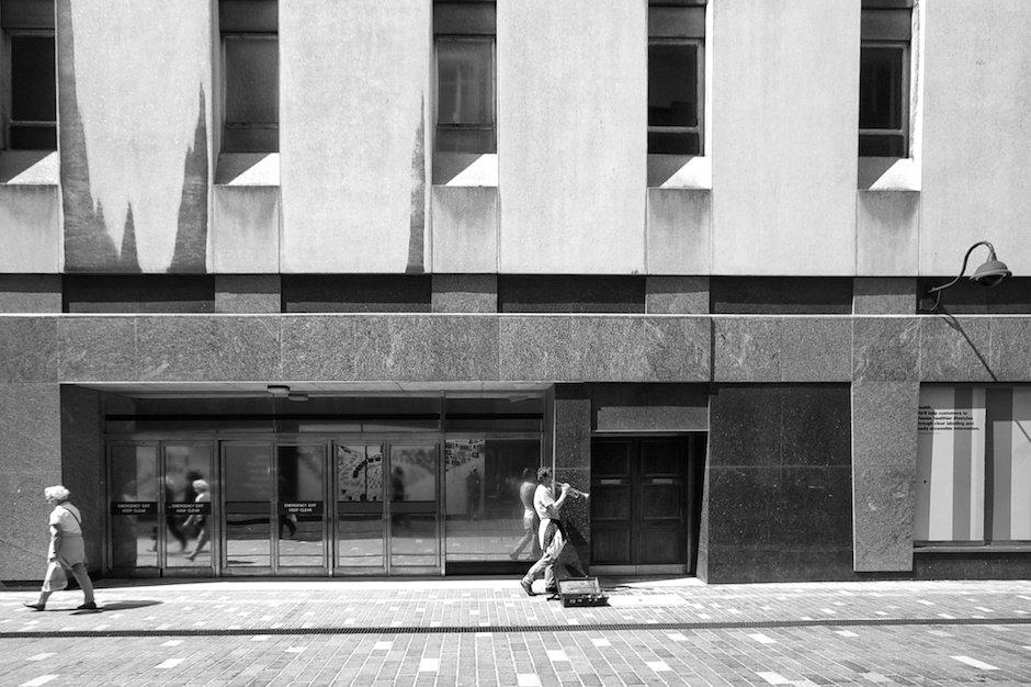Shoppers and busker reflected in shop windows - Basnett Street, Liverpool