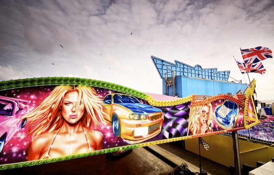 Bridlington - British seaside town shoot, glamour girl painted on dodgems with union jacks