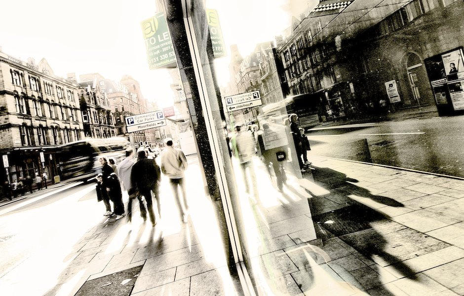 View of Dale Street reflected in shop window on a bright afternoon