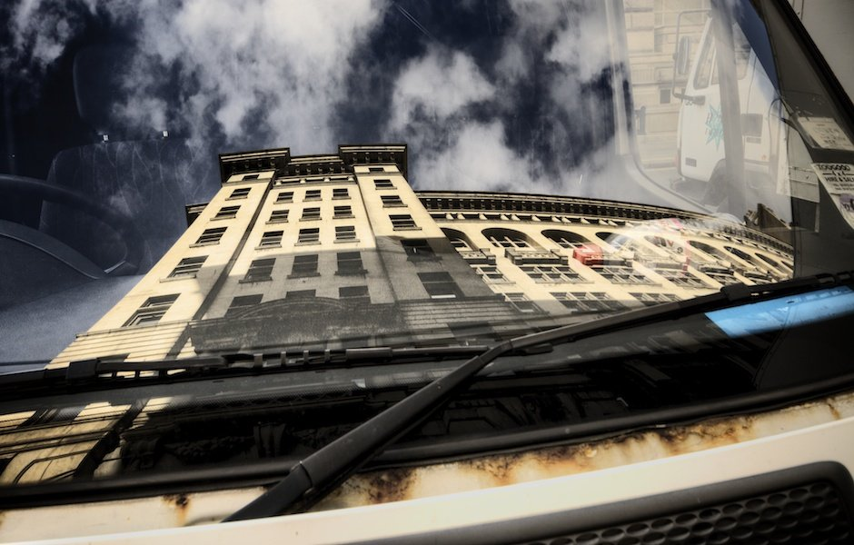 The Liver Buildings reflected in the windscreen of a Transit van parked outside