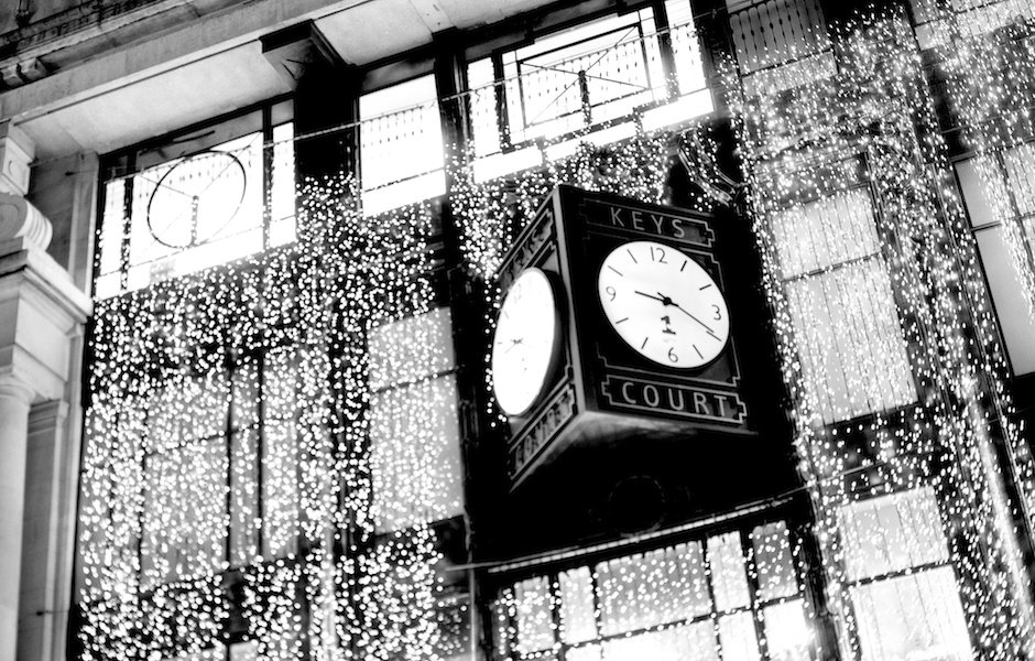 Black and white image of clock at Keys Court decorated for Christmas, Liverpool One