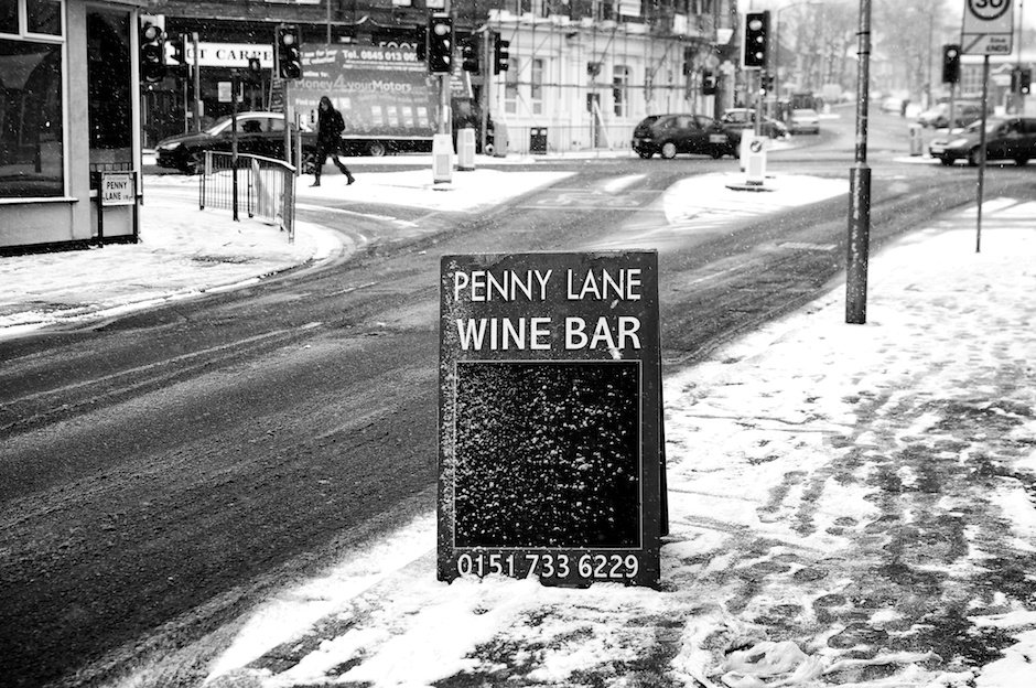 Penny Lane Wine Bar sign in snow, Liverpool