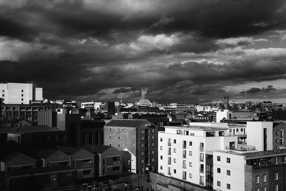 Black and white image of the Catholic Cathedral against the skyline, Liverpool city centre