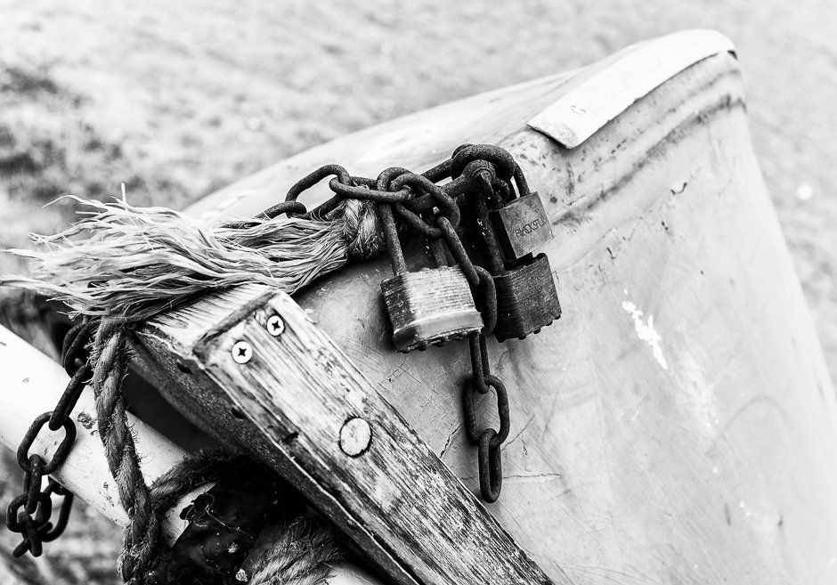 Padlock and chain on small boat, Rhos-on-sea, North Wales