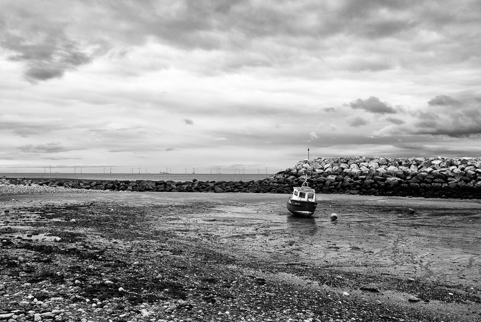 Small boat near fishing weir, Rhos-on-sea, North Wales
