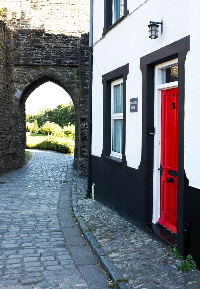 Red door house with castle in background  - Conwy, North Wales