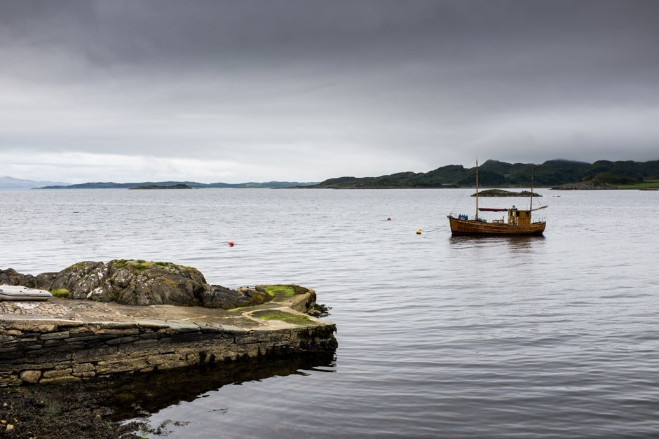 Fishing boat pictured with jetty, Crinan, Scotland