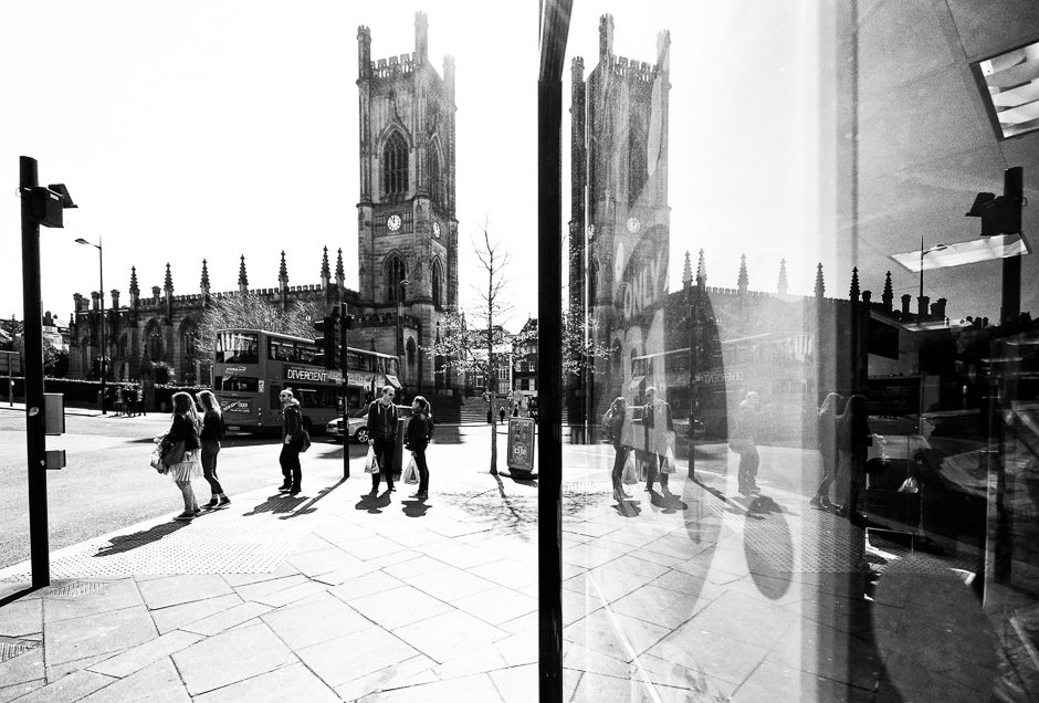 St Lukes Reflected in shop window, black and white