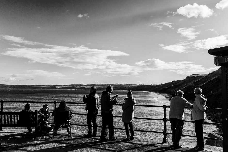 People looking out to sea from harbour, Filey