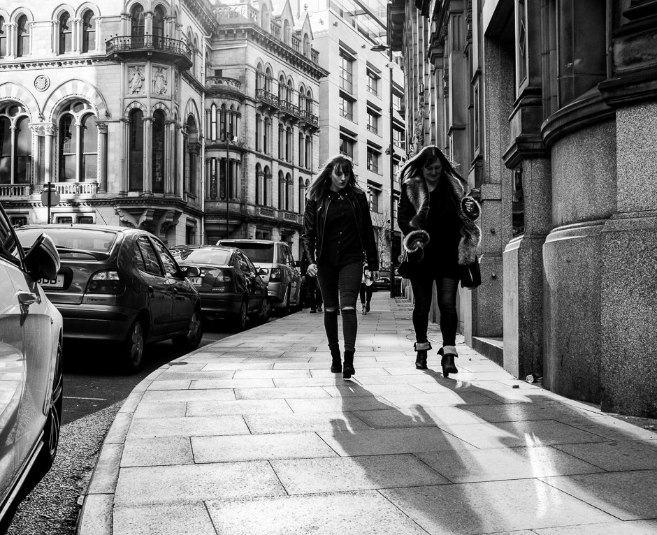 Two women on Manchester street, black and white image
