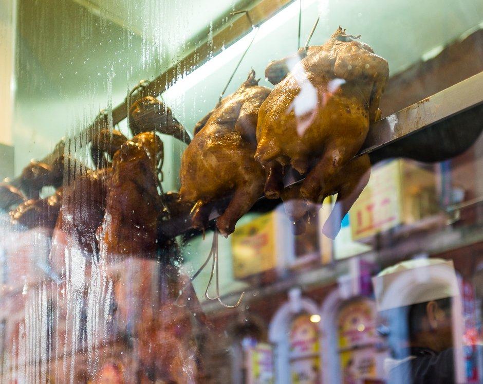 Roast duck in shop window, Chinatown, Manchester