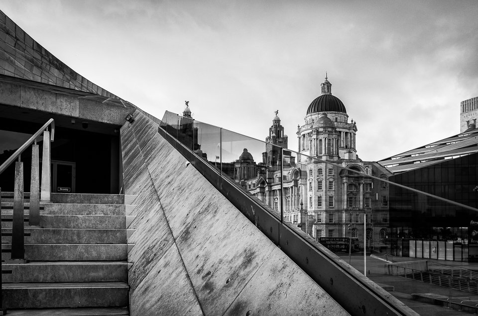 Black and white photograph of the Port Of Liverpool Building, viewed from the Museum of Liverpool steps